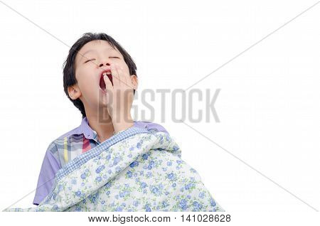 Young asian boy yawning over white background