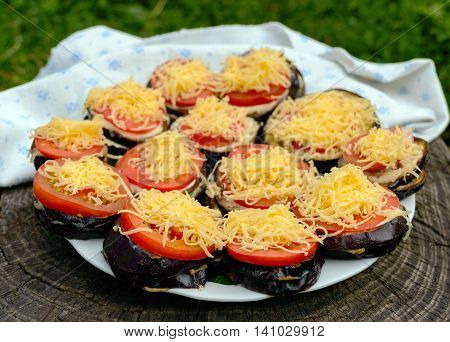 Grilled slices of eggplant with tomato spicy sauce and grated cheese