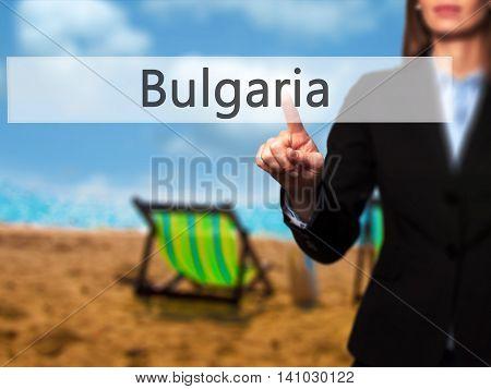 Bulgaria - Businesswoman Pressing Modern  Buttons On A Virtual Screen