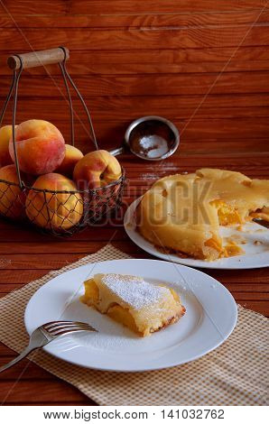 Peach caramel turnover pie sprinkled with sugar powder. Delicious summer dessert.