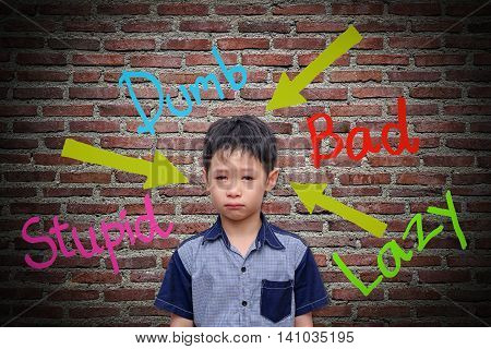 Abusive words hurt on the wall with sad boy