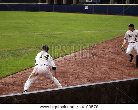Cal Player Dig Ball Out Of Dirt And Sets To Throw Into The Infield