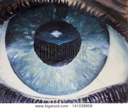 Human eye close-up with reflection of mountains and sky