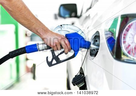 Close up of a person pumping gas