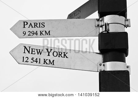 Cape Point distance sign to Paris and New York, in South Africa, near Cape of Good Hope - in black and white.