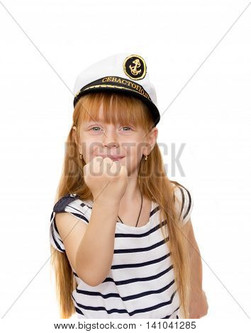 The girl in the marine cap on white background showing a fist