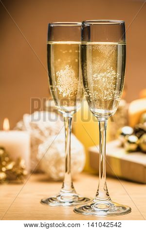 Champagne Glasses with Christmas Decorations and Presents