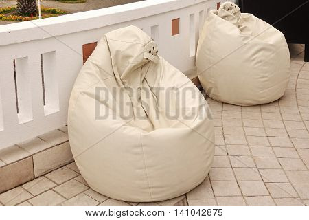 Two  Outdoor Leather White Bean Bag Chairs, Close Up