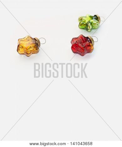 Christmas and new year red, green and gold toys. Glassy vintage stars isolated on a light background