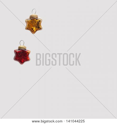 Christmas and new year red and gold toys. Glassy vintage stars isolated on a light background