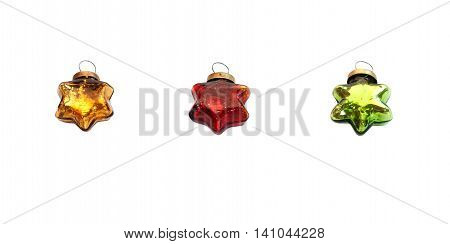 Christmas and new year red, green and gold toys. Glassy vintage stars isolated on a white background