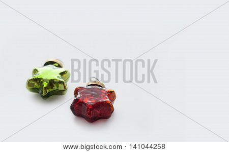 Christmas and new year red, green gold toys. Glassy vintage stars isolated on a white background