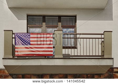 Balcony With Hanging American Flag On The Handrail Horizontal Image