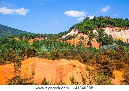 Languedoc - Roussillon, Provence, France. Reserve - quarry for ocher mining. Orange and red picturesque hills