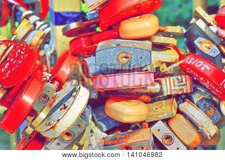 Love Heart Locks. Many Colorful Padlocks Tree Background