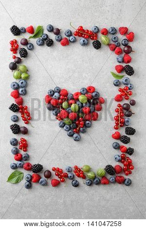 Mixed Berries Shaped As A Heart And Frame