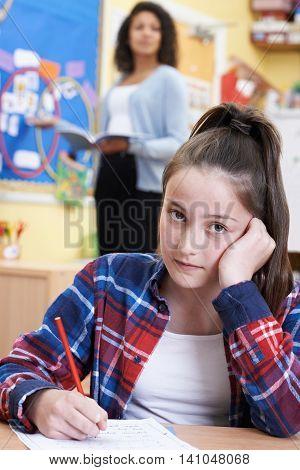 Female Elementary School Pupil Struggling In Class