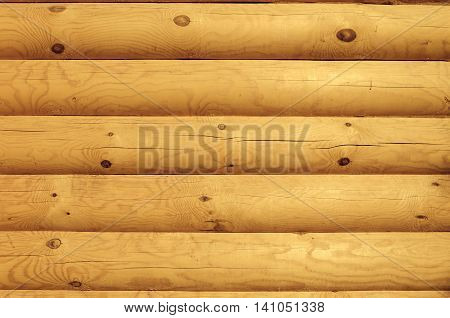 Shield with a large number of parallel wooden logs - closeup background