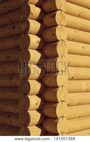 Closeup view corner of wooden house made natural logs - wooden construction background