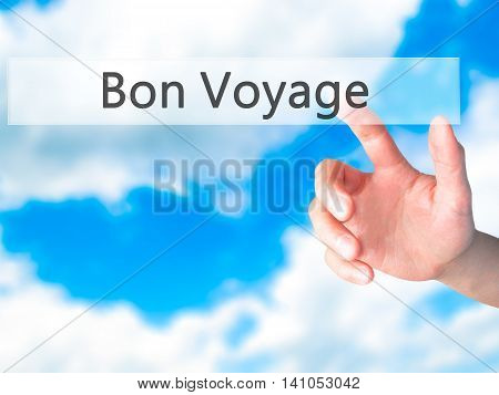 Bon Voyage (have A Good Trip In French) - Hand Pressing A Button On Blurred Background Concept On Vi