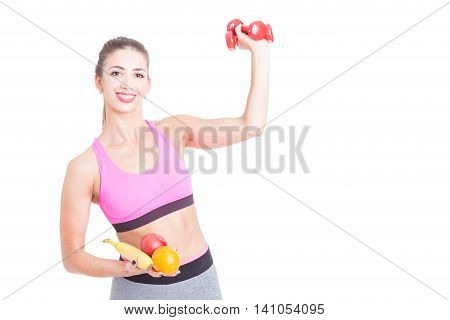 Girl Holding Weights And Fruits In Both Hands