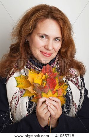 Woman With Colorful Autumn Maple Leaves
