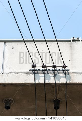 Small electric wire on the high bridge for electronic billboards of the express way.