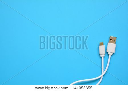 Usb. Universal serial bus on blue background.