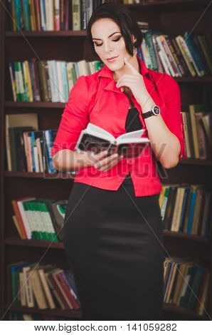 Beautiful Young Brown-haired Woman In Office Attire Standing Near Bookshelves