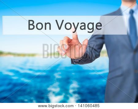 Bon Voyage (have A Good Trip In French) - Businessman Hand Touch  Button On Virtual  Screen Interfac
