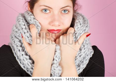 Woolen Scarf. Gray Scarf Around Her Neck Isolated On Pink Background.