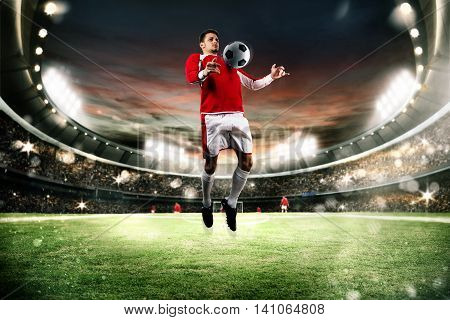 Football player parry the ball in the field of a stadium