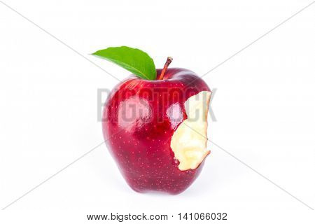 Red apple with green leaf and missing a bite