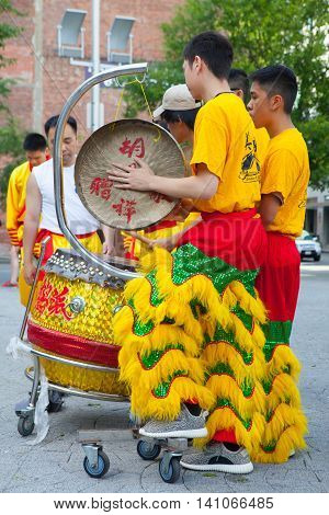 BOSTON USA - JULY 2 2016: Dragon dance - performers with the dragon costume.China Town in Boston is the only surviving historic ethnic Chinese area in New England