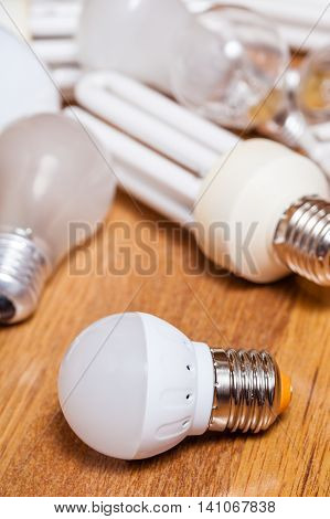 Energy Saving Led Lamp And Pile Of Old Bulbs