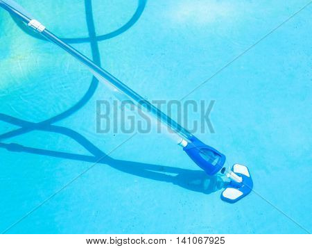 Cleaning Swimming Pool By Vacuum Cleaner