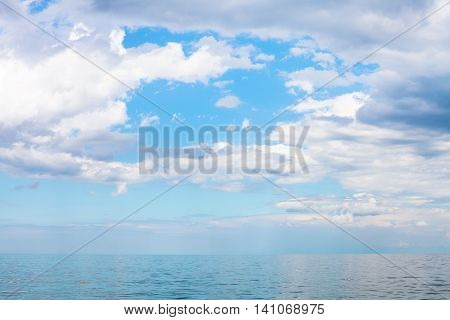 Scenery Of Blue Sky With White Clouds Over Calm Sea