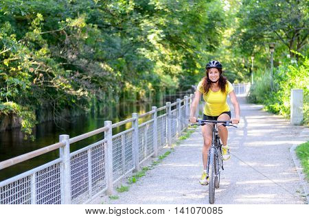 Attractive Active Young Woman Riding A Bicycle