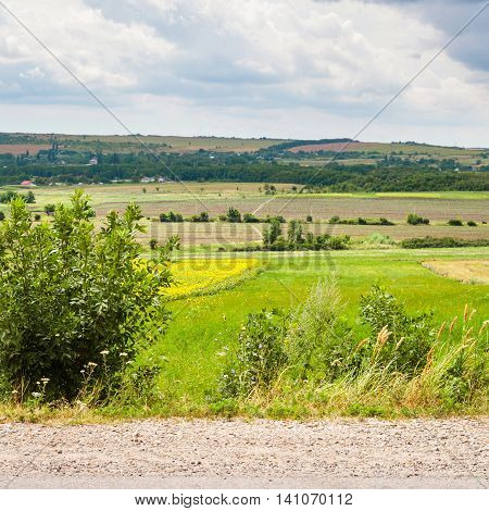 Country Landscape With Road, Fields And Village