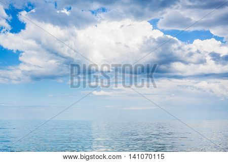 Clouds In Blue Sky Over Calm Water Of Azov Sea