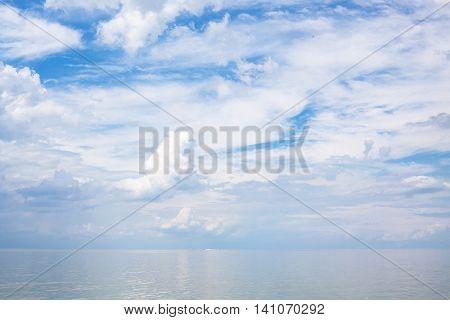 White Clouds Over Calm Blue Water Sea Of Azov