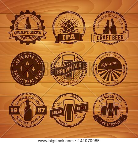 Set of vector craft beel labels. Beer logos on vintage wooden background