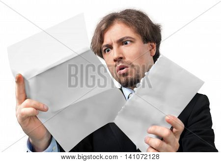 Portrait of a Scared Businessman Looking at Some Documents