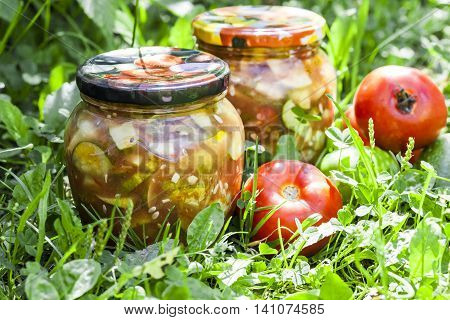 glass jars with homemade pickles harvested for storage