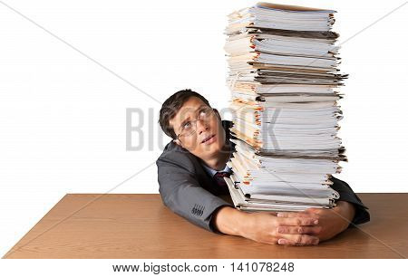 Portrait of a Worried Employee Behind a Stack of Documents