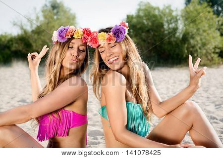 Beautiful bohemian styled and tanned girls at the beach