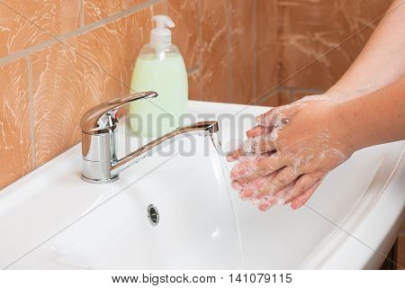 Woman Washing Hands. Cleaning Hands. Hygiene microbes