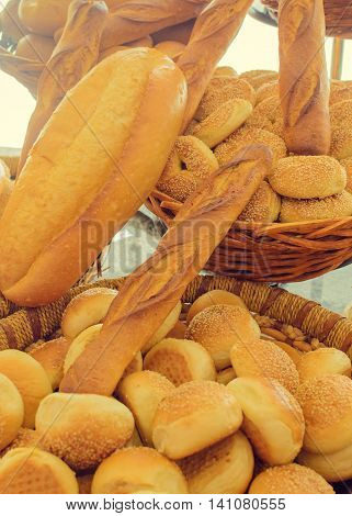 A lot of different bread. Arrangement of different breads at the bakery. Different types of breads and buns.