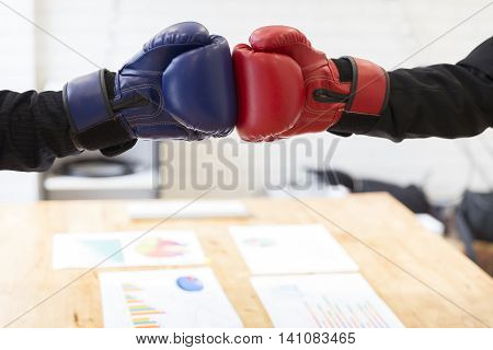 Businessman In Suit With Red And Blue Boxing Gloves