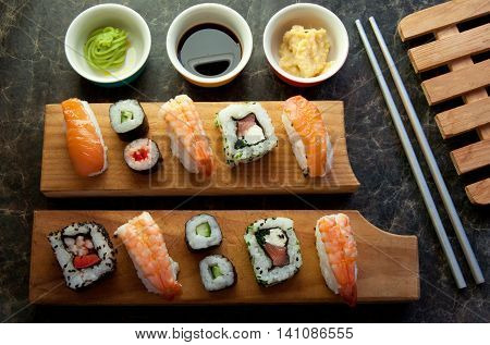 Selection of sushi including prawns salmon and vegetables with rice